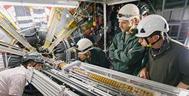 Engineers looking at equipment